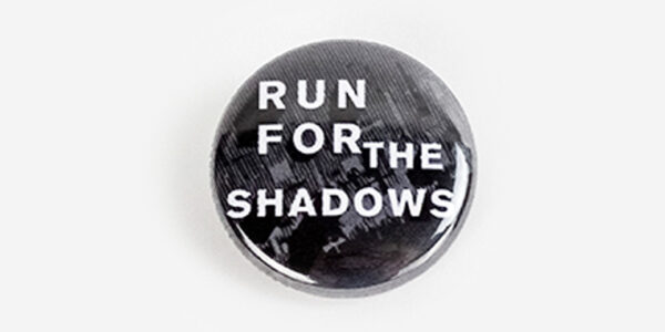 Underground England run for the shadows button badge in black and white