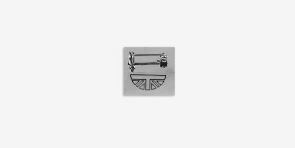 Underground England post punk enamel badge metal pin black and silver
