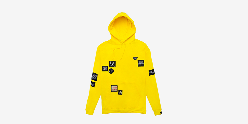 Heavyweight pullover Yellow hoodie with embroidered patches at the front