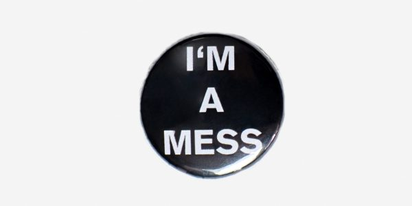 Underground England Black and white i'm a mess text button pin badge
